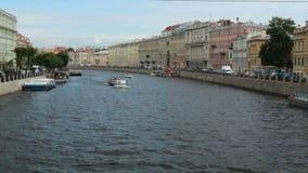 Russia St. Petersburg Fontanka river ships summer tourism. Facade stock video footage
