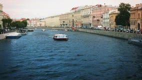 Russia St. Petersburg Fontanka river ships summer tourism. Facade stock footage
