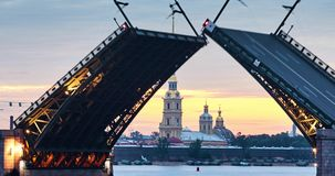 Russia, St. Petersburg 29 June 2016: Opens rises Palace Bridge. On the background of the Peter and Paul fortress, Petropavlovskaya, water navigation, sinrise stock video