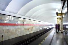 Russia, St. Petersburg, passengers stand on the platform subway Stock Photo