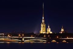 Russia, St. Petersburg, 06/20/2015: Peter and Paul Fortress, hig. Hlighted Trinity Bridge, the river Neva, night landscape, illuminated sights of St. Petersburg Stock Photography