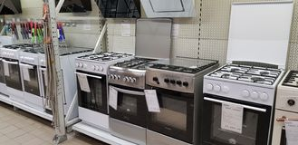 Rows of gas stoves selling in home appliance store royalty free stock image