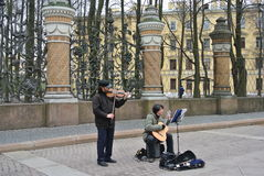 Russia, St. Petersburg street musicians playing musical instruments on the background of the lattice of the Summer Garden Royalty Free Stock Image
