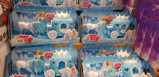 Toy princess and horse with a coach in the store stock image