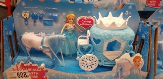 Toy princess and horse with a coach in the store stock photos