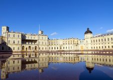 Russia, suburb of St. Petersburg. Great Gatchina Palace  and parade-ground. Reflection in pools after a rain. Russia, suburb of St. Petersburg. Great Gatchina Stock Photos
