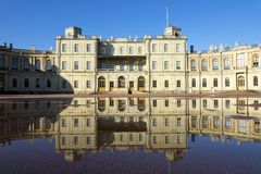 Russia, suburb of St. Petersburg. Great Gatchina Palace 1766 - 1781 and parade-ground. Reflection in pools after a rain.  Stock Photo