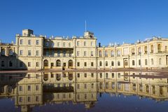 Russia, suburb of St. Petersburg. Great Gatchina Palace 1766 - 1781 and parade-ground. Reflection in pools after a rain.  Stock Photos