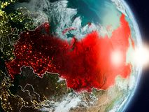 Russia during sunrise. Highlighted in red on planet Earth with visible country borders. 3D illustration. Elements of this image furnished by NASA Royalty Free Stock Photo