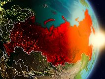 Russia during sunrise. Highlighted in red on planet Earth with visible country borders. 3D illustration. Elements of this image furnished by NASA Stock Photos