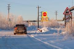 Railway crossing in winter. Road sign stock photos