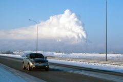 Vew of Surgut GRES-2 from Nizhnevartovsk-Surgut highway, on a frosty winter day. The pipes of thermal power plants smoke. Russia, Surgut, November 29, 2018: view royalty free stock photo