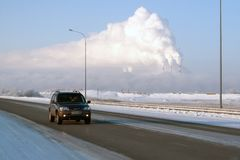 Vew of Surgut GRES-2 from Nizhnevartovsk-Surgut highway, on a frosty winter day. The pipes of thermal power plants smoke. Russia, Surgut, November 29, 2018: view stock photo