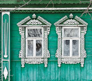 Russia. Suzdal. Two windows with carved wooden stock photography