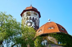 Russia, Svetlogorsk, 08. 10. 2017. The old water tower Rauchen, decorated with watches with stucco. selective focus. stock photography