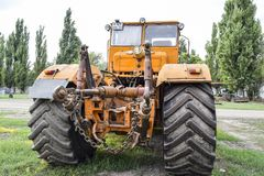The Big tractor. Russia, Temryuk - 15 July 2015: Big tractor. Old Soviet agricultural machinery Stock Photos