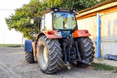 Tractor, standing in a row. Agricultural machinery. Russia, Temryuk - 15 July 2015: Tractor, standing in a row. Agricultural machinery. Parking of agricultural Royalty Free Stock Photo