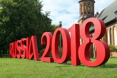 Russia 2018. The text 'Russia 2018' written in big red letters in a garden royalty free stock photo