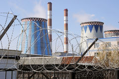 Russia, thermal power station over a barbed wire fence Royalty Free Stock Image