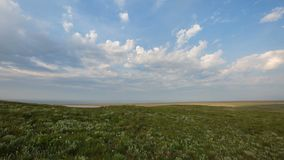 The movement of clouds in the spring in the steppe part of the Crimea peninsula at Cape Opuk. Russia, time lapse. The movement of clouds in the spring in the stock video footage