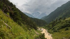 Movement of clouds and water flows in a stormy river in the Caucasus mountains in summer. Russia, time lapse. Movement of clouds and water flows in a stormy stock video