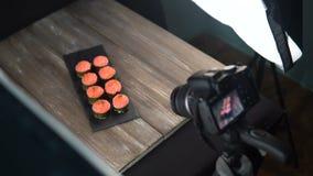 RUSSIA, TOGLIATTI - NOVEMBER 19, 2018: Food photography, camera on a tripod, shooting sushi rolls in photo Studio. stock video