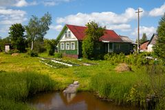 Old wooden house in rural vegetable garden stock image