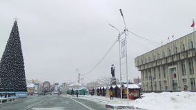 Russia, Tula, December 14, 2018, noon. Lenin square. Christmas decorations and entertainment. Christmas shopping arcade. View from the square to the city hall stock footage