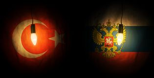 Russia and Turkey flags. Flags of Russia and Turkey illuminated by light from light bulbs. Mutual relations of countries royalty free illustration