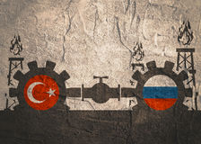 Russia and Turkey flags on gears. Image relative to gas transit from Russia to Turkey. Gears connected by gas pipe. National flags on cog wheels. Concrete Stock Photo