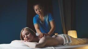 RUSSIA, Ufa - APRIL 06, 2018: Woman receives body massage at spa salon stock footage