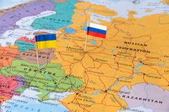 Russia and Ukraine map concept image hot spot defending territory. Russia and Ukraine flag pins on map, neighboring countries fighting for their territories Royalty Free Stock Photography