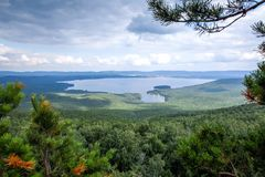 Mountain lake on a background of mountains royalty free stock photography