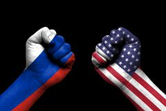 Russia and USA conflict, international relations crisis, flag on human hand background concept