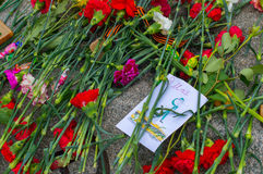 RUSSIA - Victory Day on May 9. RUSSIA - MAY 09: card at the grave of a soldier in honor of Victory Day Royalty Free Stock Image