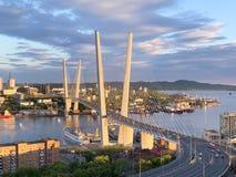 Russia, Vladivostok. Golden bridge in the setting sun stock images