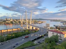 Russia, Vladivostok. Golden bridge in the setting sun royalty free stock images