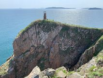 Russia, Vladivostok, Island of Shkot. Cape  of lighthouse.  stock photos