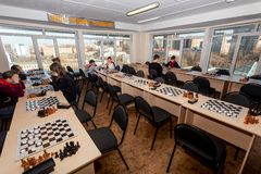 Russia, Vladivostok, 12/01/2018. Kids play chess during chess competition in chess club. Education, chess and mind games. stock photo
