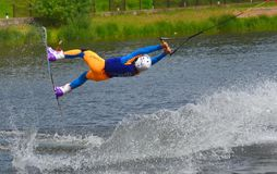 The athlete with snowboard hold on to the rope and the boat accelerates. Russia, Volgodonsk - June 18, 2015: Water snowboard. The athlete with snowboard hold on Stock Photos