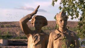 Russia.Vologda.Bronze figures of Soviet pioneers. Bronze figures of Soviet pioneers on the background of the landfill