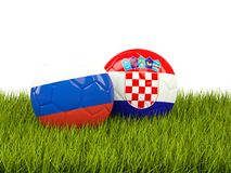 Russia vs Croatia. Soccer concept. Footballs with flags on green Royalty Free Stock Photo