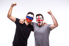 Russia vs England on white background. Football fans of national teams celebrate, dance and scream. European football fans concept Royalty Free Stock Photography