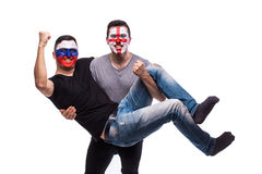 Russia vs England on white background. Football fans of national teams celebrate, dance and scream. European football fans concept Royalty Free Stock Photos