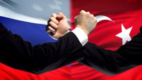 Russia vs Turkey confrontation, countries disagreement, fists on flag background. Stock photo stock photo