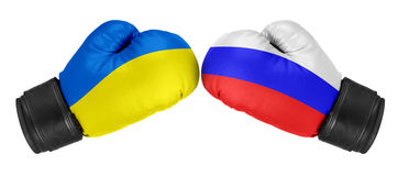 Russia vs Ukraine. Boxing gloves with Ukraine and Russia flag. Isolated on white Royalty Free Stock Photos