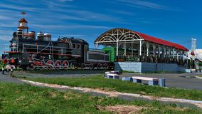 Russia. Western Siberia. Old locomotive with wagon as a children's cafe Stock Images