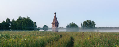 Russia. wooden chapel in the field Stock Photography