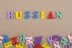 Russia word on paper background composed from colorful abc alphabet block wooden letters, copy space for ad text. Russia word on background composed from royalty free stock image