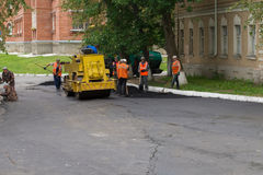 Russia. Workers laid asphalt. Royalty Free Stock Images